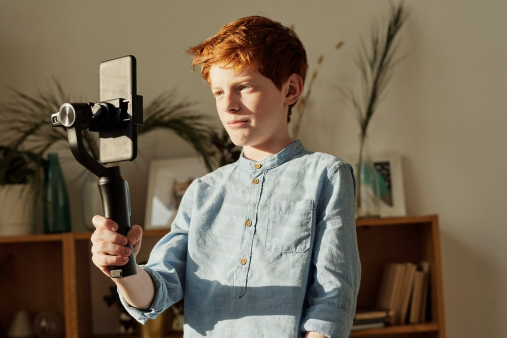 boy recording with mobile phone